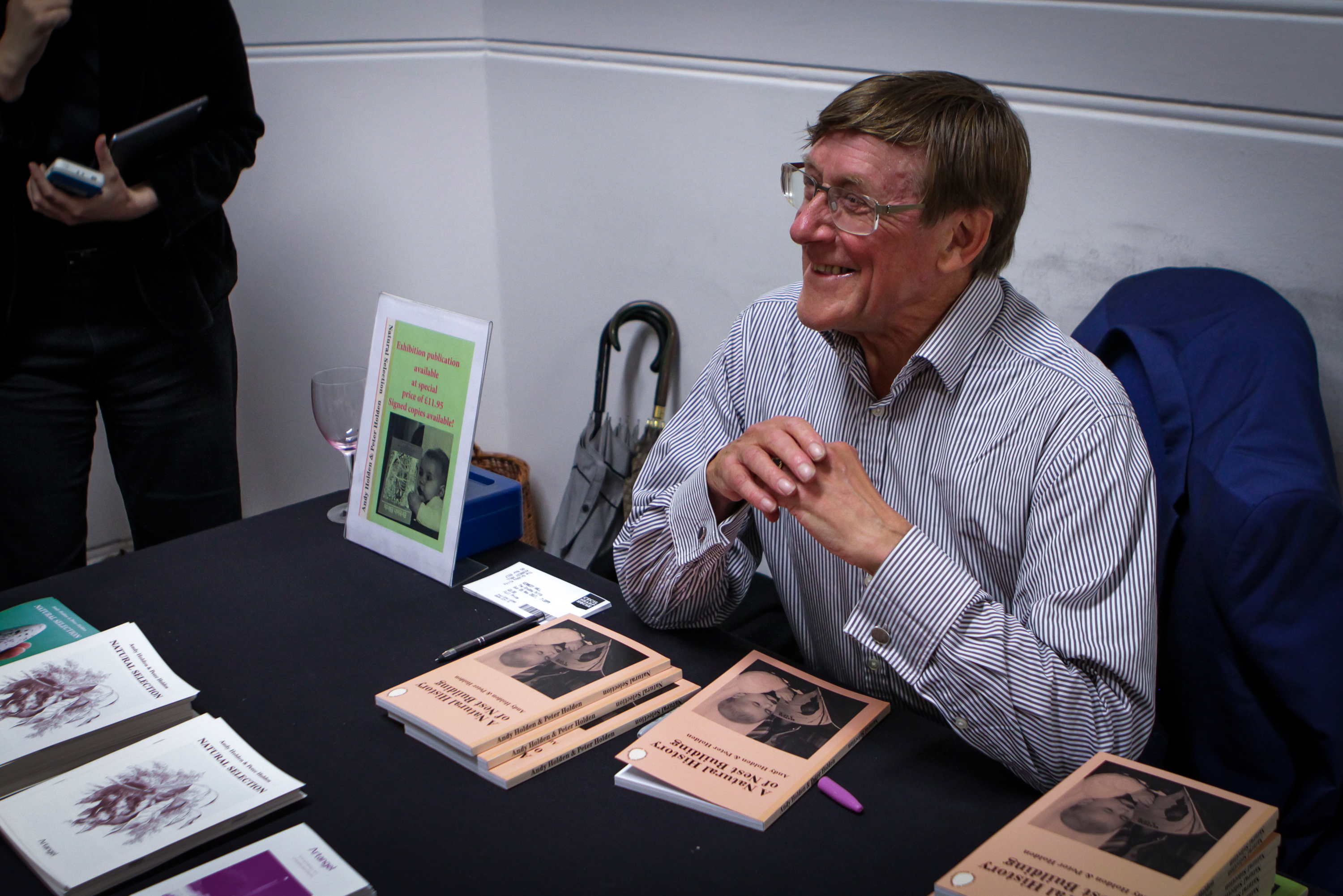 Peter Holden signing copies of A Natural History of Nest Building by Andy Holden and Peter Holden